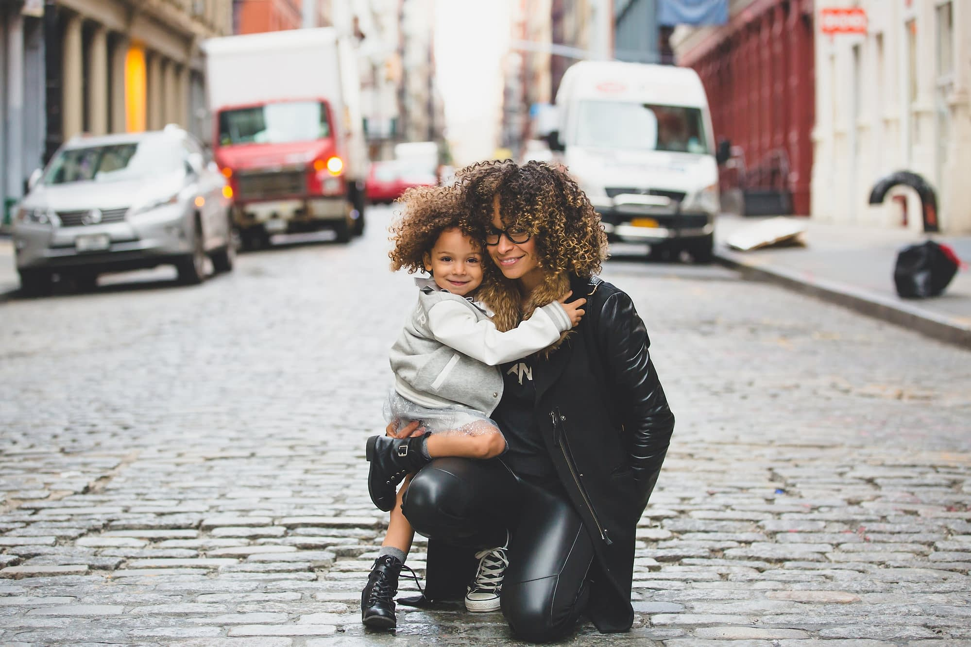 woman and little girl on street
